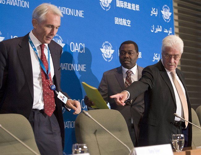 Tony Tyler, the International Air Transport Association director general and CEO (left), Dr. Olumuyiwa Benard Aliu, centre, president of the International Civil Aviation Organization, and Raymond Benjamin, right, ICAO Secretary General, arrive for a news conference on Tuesday in Montreal. (Ryan Remiorz/The Canadian Press)