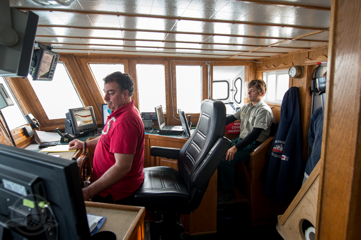 David McIsaac (Captain) at the helm of the MV Martin Bergmann and Charles Dagneau operating the sonar in the early hours of the morning in the southern search area.