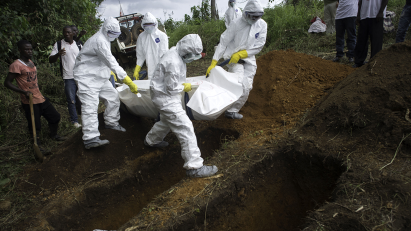 A WHO team buries the bodies of deceased patients whose families did not come near the Médecins Sans Frontières (MSF) Ebola Treatment Center in Kailahun, Sierra Leone.