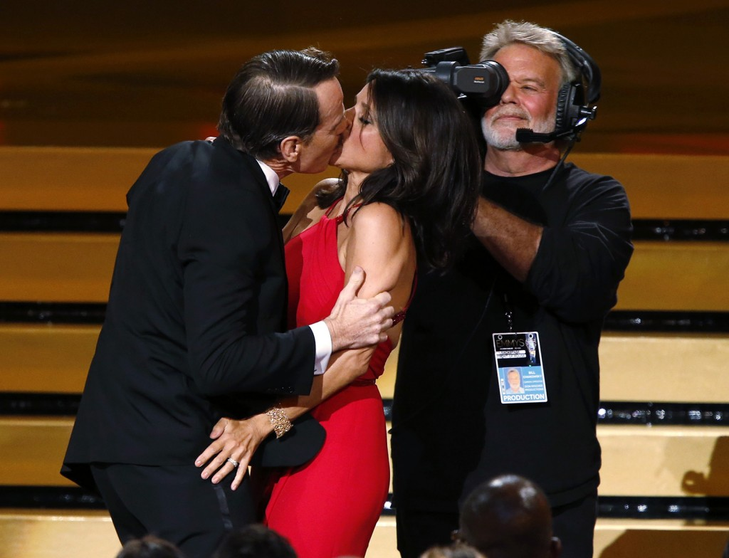 "Actor Bryan Cranston engages Julia Louis-Dreyfus in a prolonged kiss as she takes the stage to accept the award for for Outstanding Lead Actress In A Comedy Series for her role in HBO's ""Veep"" onstage during the 66th Primetime Emmy Awards. (Mario Anzuoni/Reuters)"