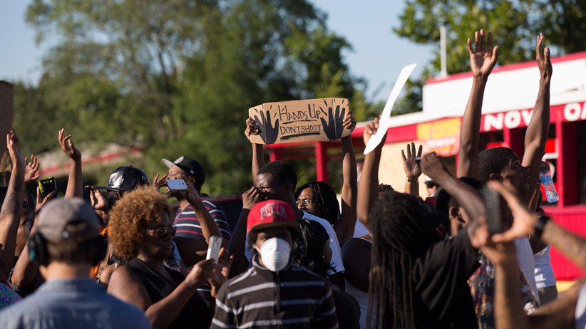 Demonstrators raise their hands while protesting the shooting death of teenager Michael Brown, in Ferguson, Missouri August 13, 2014. (Mario Anzuoni/Reuters)