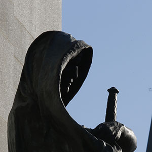 A statue entitled 'Justice' in front the Supreme Court of Canada is framed with the Peace Tower on Parliament Hill in Ottawa