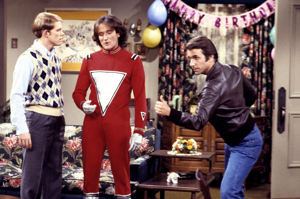 Robin Williams as Mork in a 1979 episode of Happy Days, alongside Ron Howard and Henry Winkler (ABC PHOTO ARCHIVES)