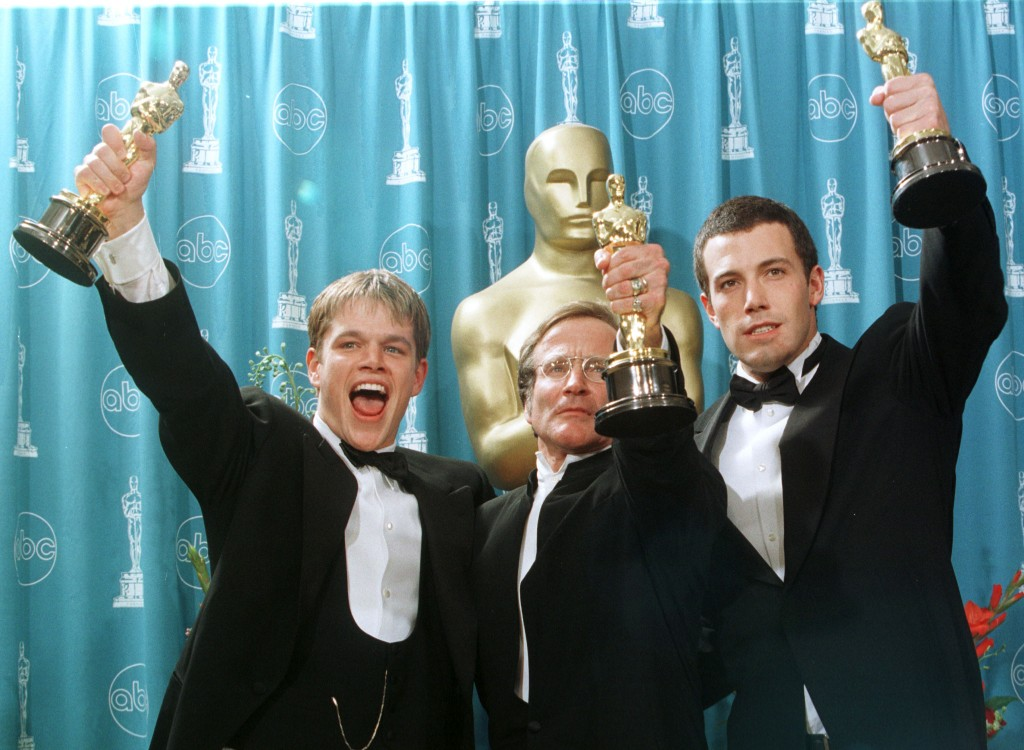 Matt Damon, Williams and Ben Affleck celebrate their Oscar wins for Goodwill Hunting in 1998 (REUTERS/Sam Mircovich)