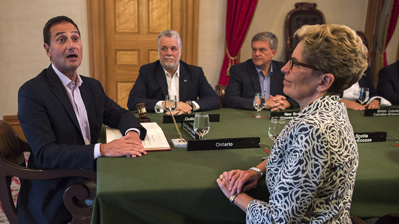 Prince Edward Island Premier Robert Ghiz, Quebec Premier Philippe Couillard, New Brunswick Premier David Alward and Ontario Premier Kathleen Wynne, left to right, attend the opening session at the Council of the Federation meeting in Charlottetown on Thursday, August 28, 2014. THE CANADIAN PRESS/Andrew Vaughan