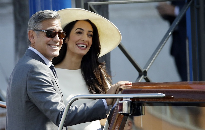 Last in a series: George Clooney and Amal Alamuddin leave Venice's city hall on Monday.