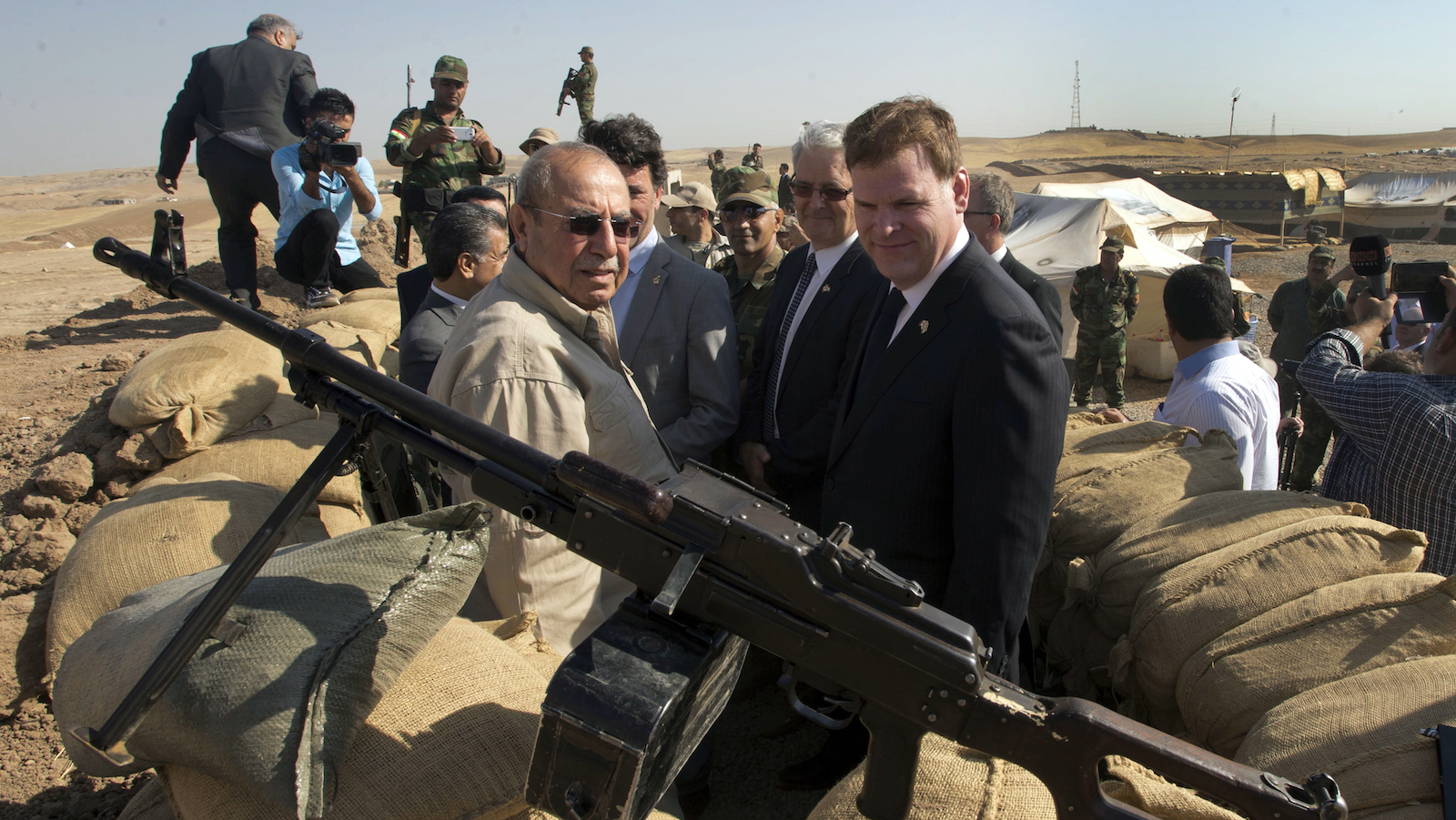Canadian Foreign Affairs Minister John Baird, right, andIraqi Deputy Minister Rowsch Nouri Sharways look at the ISIS positions from a front line bunker Thursday, September 4, 2014 in Kalak, Iraq. THE CANADIAN PRESS/Ryan Remiorz