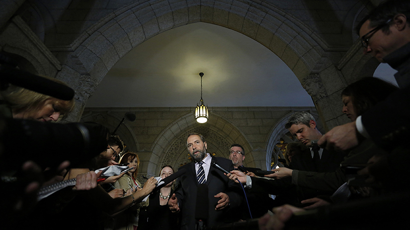 NDP leader Mulcair speaks to journalists in the Senate foyer on Parliament Hill in Ottawa