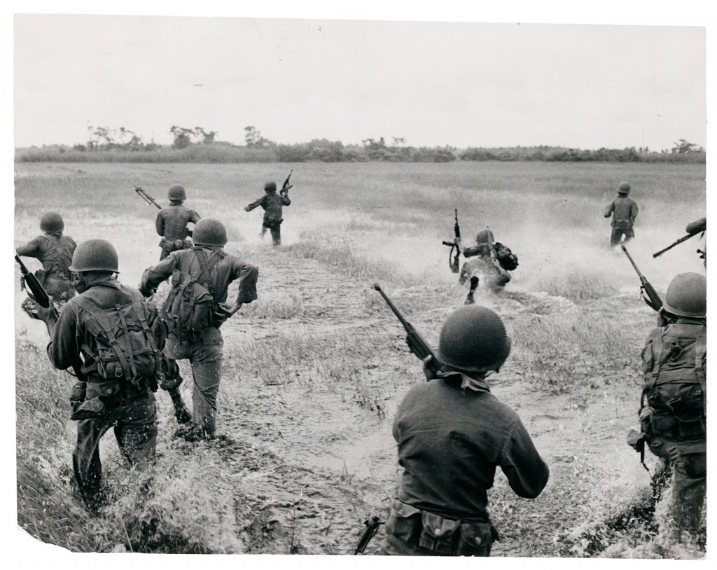 Doctored: The combat filed in this Vietnam War photo by François Sully appears to have been expanded, and the position of some soldiers changed.  (François Sully, Untitled [Vietnam], 16 July 1962. The Black Star Collection, Ryerson Image Centre.)