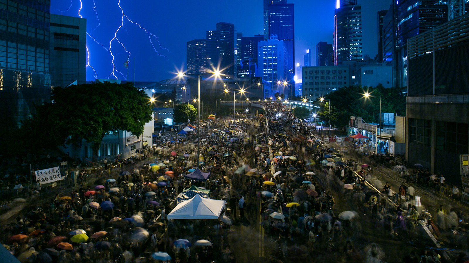 Demonstrators gather outside the central government complex in Hong Kong