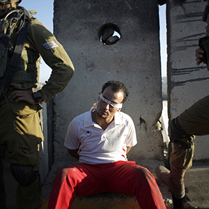 Israeli soldiers detain a Palestinian during clashes at a protest against the Jewish settlement of Ofra near Ramallah