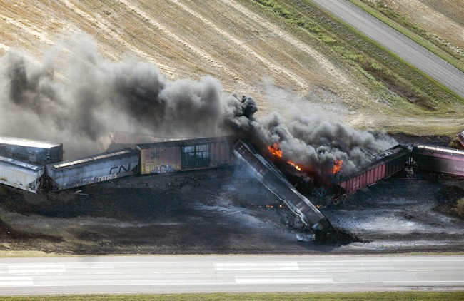 A CN freight train carrying dangerous goods derailed in central Saskatchewan, near the town of Wadena, and caught fire, Tuesday, October 7, 2014. (Liam Richards/The Canadian Press)