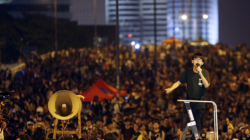 Joshua Wong, leader of the student movement, delivers a speech as protesters block the main street to the financial Central district, outside the government headquarters building in Hong Kong October 1, 2014. (Carlos Barria/Reuters)