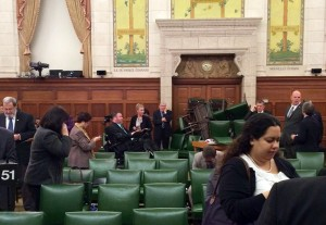 Members of the Conservative caucus barricade themselves in a meeting room on Parliament Hill in Ottawa. (AP Photo/The Canadian Press, Nina Grewal)