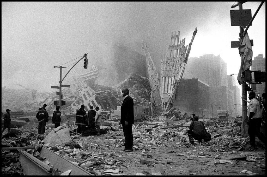 Ground zero: A church minister stands amid the wreckage of New York's World Trade Center after the 9/11 attacks.