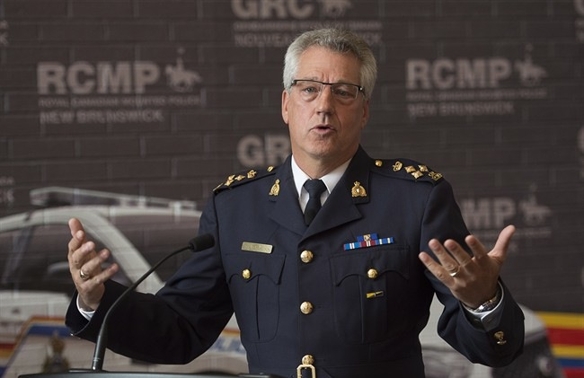 RCMP Assistant Commissioner Roger Brown announces the death of RCMP Cpl. Ron Francis at a news conference in Fredericton on Tuesday, October 7, 2014. Francis made national headlines for smoking medicinal marijuana while wearing his red serge uniform. (Andrew Vaughan/The Canadian Press)