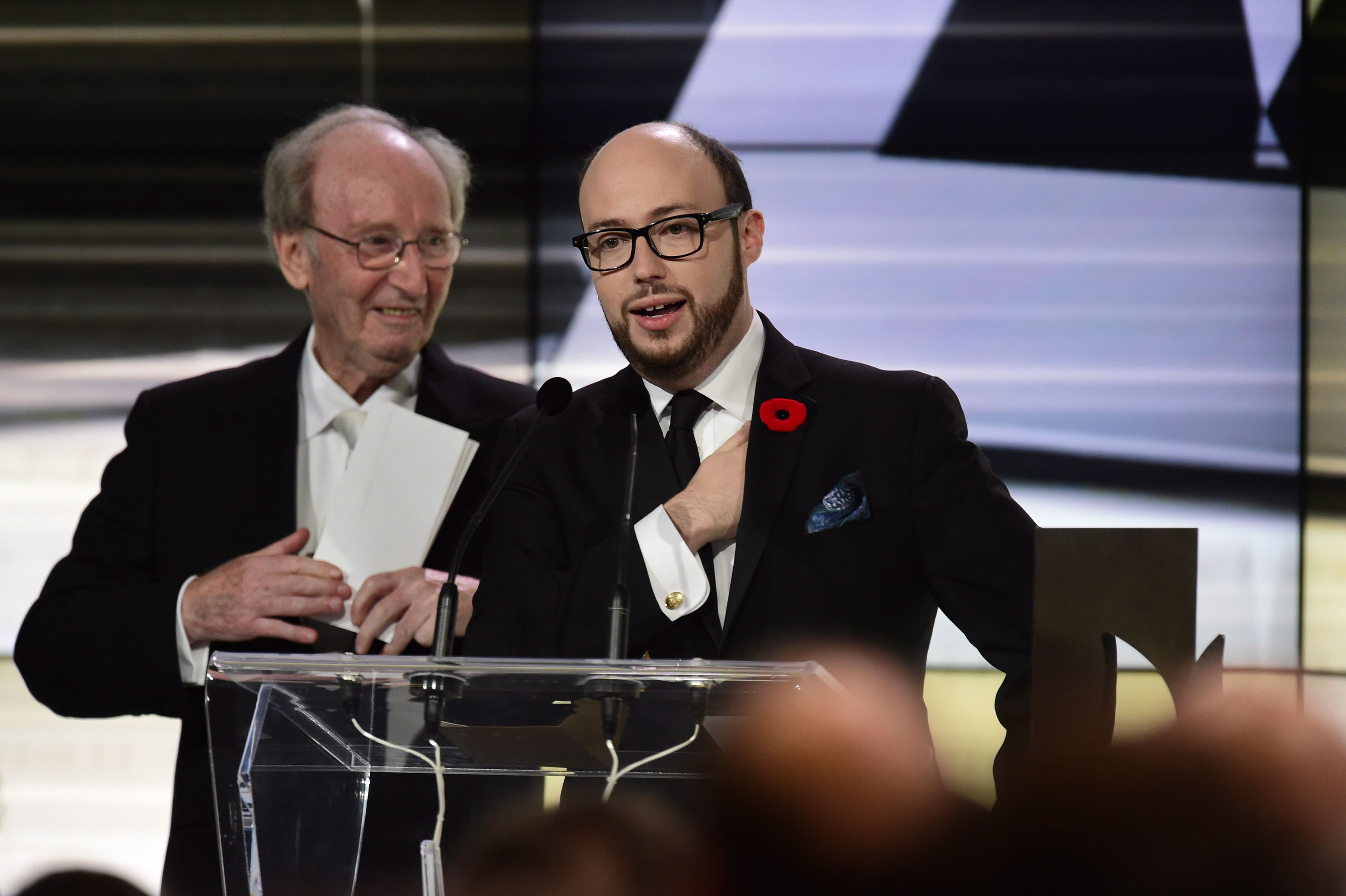 Author Sean Michaels gives his acceptance speech after winning the 2014 Giller Prize in Toronto, Monday, Nov.10, 2014. Giller Prize founder Jack Rabinovitch is pictured at left. (Frank Gunn/The Canadian Press)