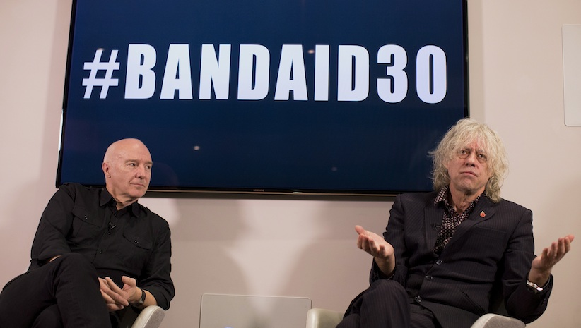 Irish singer-songwriter and campaigner Bob Geldof, right, and Scottish musician and singer-songwriter Midge Ure speak, during a press briefing in London, to announce the launch of #BandAid30. (Matt Dunham, AP Photo)