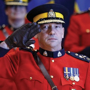 New RCMP Commissioner Paulson salutes during a change of command ceremony in Ottawa