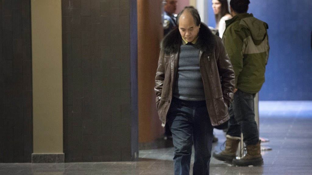 Diran Lin, father of Jun Lin, walks the halls of the courthouse during the fourth day of jury deliberations at the murder trial for Luka Rocco Magnotta Friday, December 19, 2014 in Montreal. (Paul Chiasson/The Canadian Press)