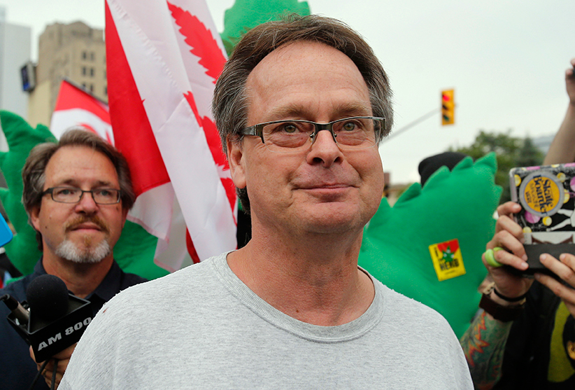 Marijuana advocate Marc Emery walks down a street following his release from an American prison for selling marijuana seeds in the U.S., in Windsor, Ontario
