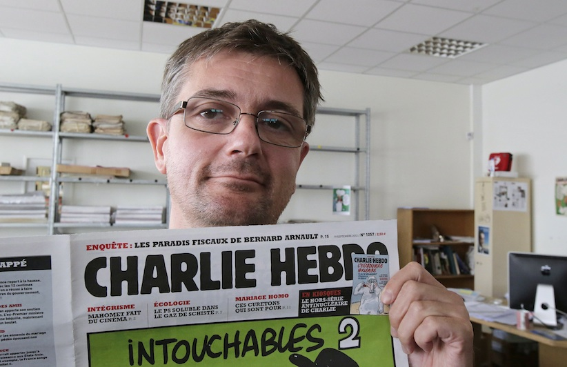 Police have confirmed that Charb, publishing director of Charlie Hebdo, was among those killed on Wednesday morning. He's shown here  in September 2012. (Michael Euler, AP Photo)
