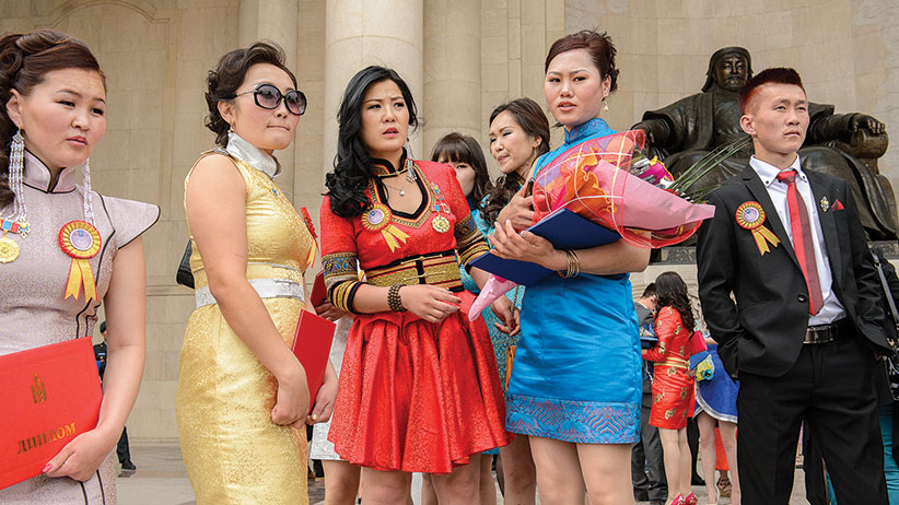 Graduation day, where high school and university students gather to celebrate in the capital's main square, which features a statue of Genghis Khan. More than 60 per cent of university graduates are women.  MDEE