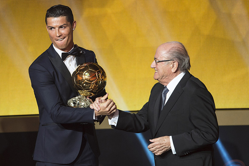 Big winner: Soccer star Cristiano Ronaldo wins the player of the year award for the second year and is congratulated by FIFA President Blatter  Ennio Leanza/EPA