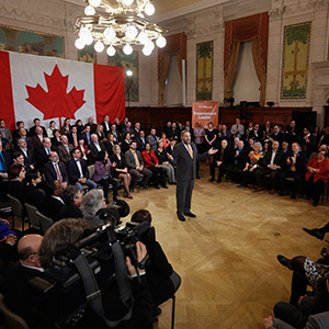 NDP leader Mulcair delivers a speech to his caucus on Parliament Hill in Ottawa