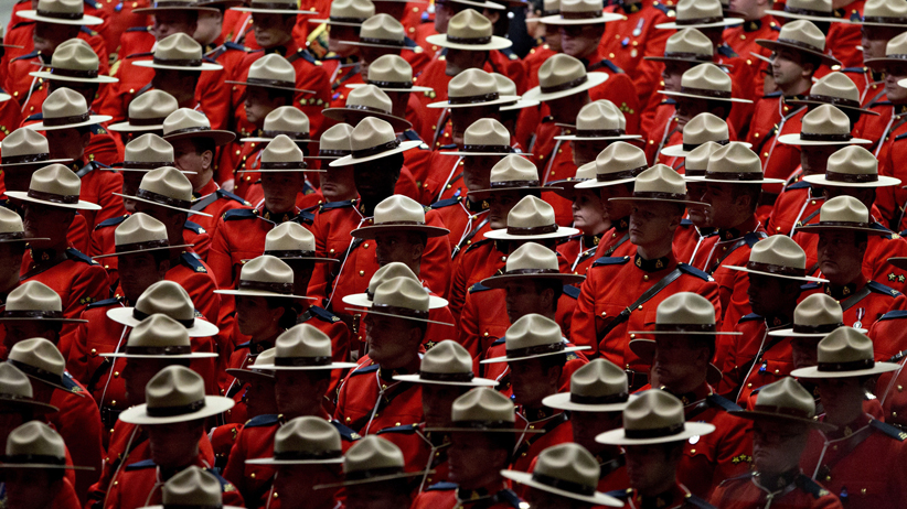 In mourning: RCMP officers attend the Jan. 26 funeral of Const. David Wynn, who died of his wounds four days after being shot in St. Albert, Alta. Jason Franson/CP