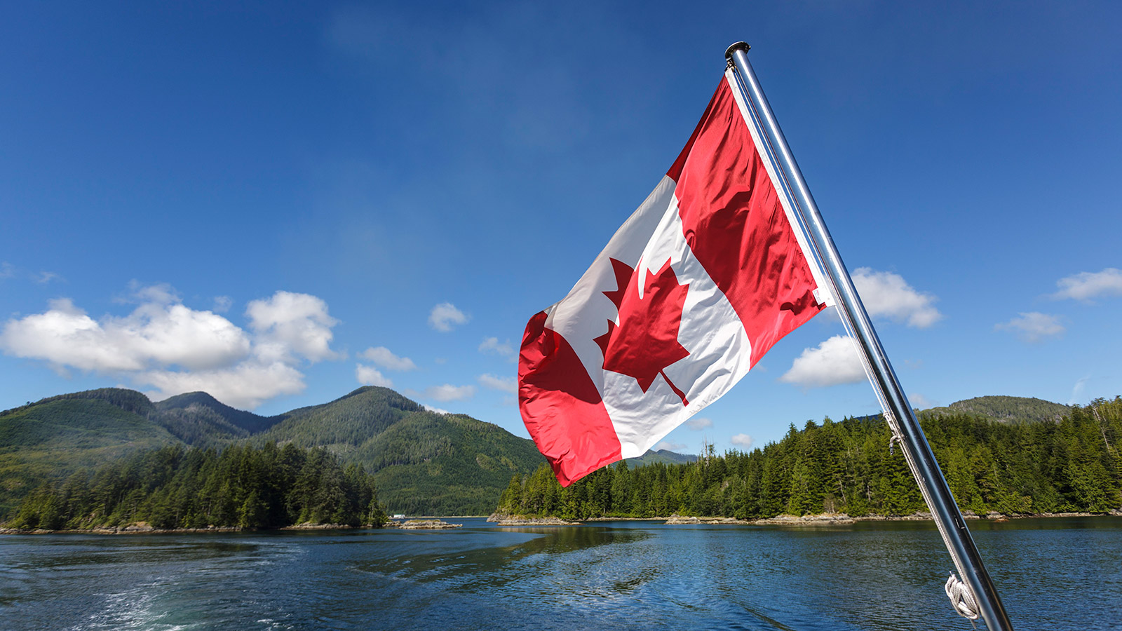 The Canadian flag flies from the stern of the Uchuck 111 as it traverses Esperanza Inlet, British Columbia, Canada. (Ron Watts/All Canada Photos/Corbis)