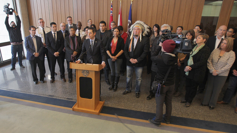 Derek Nepinak, Grand Chief of the Assembly of Manitoba Chiefs, and Winnipeg's Mayor, Brian Bowman (speaking) were among the attendees at a media conference at City Hall in Winnipeg today. A Canadian magazine declared that Winnipeg is Canada's most racist city. Thursday, January 22, 2015. (Chris Procaylo/Winnipeg Sun/QMI Agency)