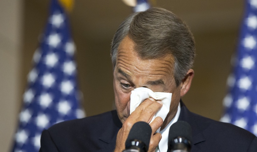 House Speaker John Boehner of Ohio, wipes away his tears, as he delivers his remarks during a ceremony honoring the members of the First Special Service Force. (AP Photo)
