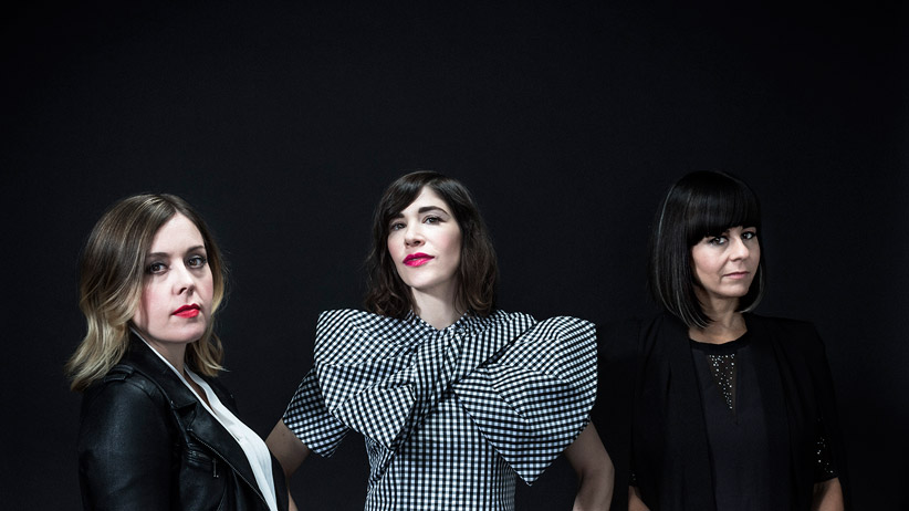 From left to right, Corin Tucker, Carrie Brownstein and Janet Weiss of Sleater-Kinney pose for a photo in New York, Dec. 2, 2014. (Chad Batka/The New York Times)