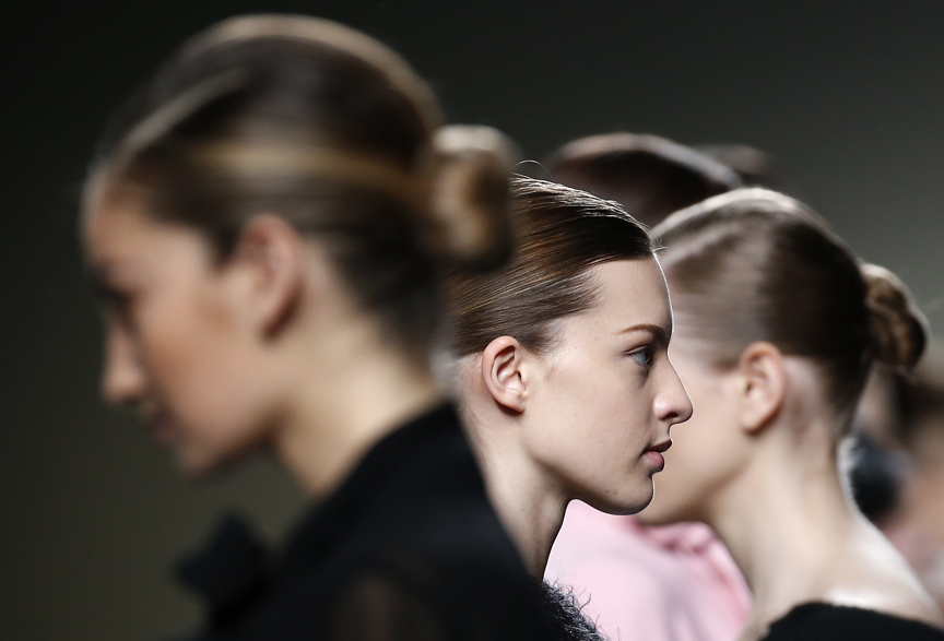Models present creations from Esther Noriega's Fall/Winter 2015 collection, during the Mercedes-Benz Fashion Week in Madrid
