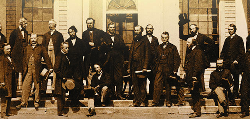 Charlottetown Conference delegates posing on the steps of Government House (Collections Canada)