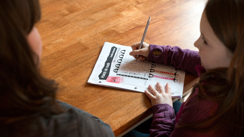 Second-grade French immersion student Alyvia Spencer does her homework with her mother, Hannah Spencer, in their Salmon Arm home. (Photograph by Mikael Kjellstrom)