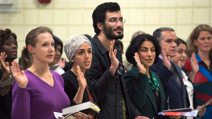 New Canadians take the oath of citizenship at a ceremony in Dartmouth Andrew Vaughan/CP