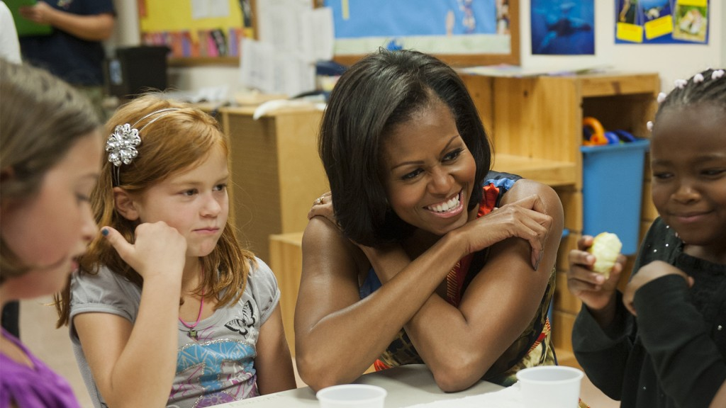 US First Lady Michelle Obama speaks with young children during a visit to the Ron Rosner Family YMCA of Spotsylvania County in Fredericksburg, Virginia. (Saul Loeb/AFP/Getty Images)