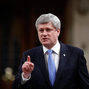 Canada's PM Harper speaks in the House of Commons in Ottawa