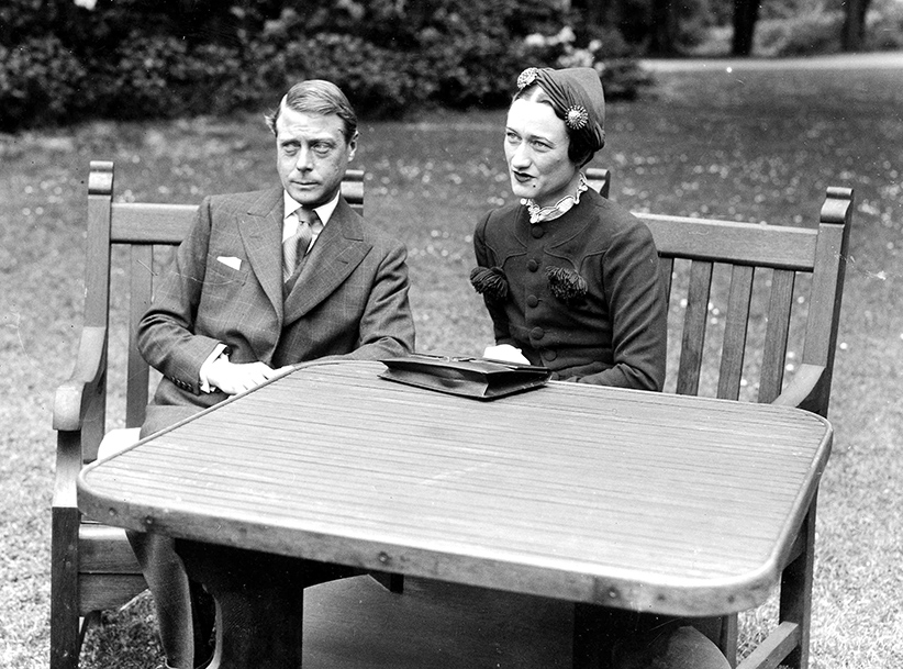 7th May 1937. The Duke of Windsor, formerly King Edward VIII, poses with Mrs. Wallis Simpson in the grounds of the Chateau de Cande, near Tours, France.
