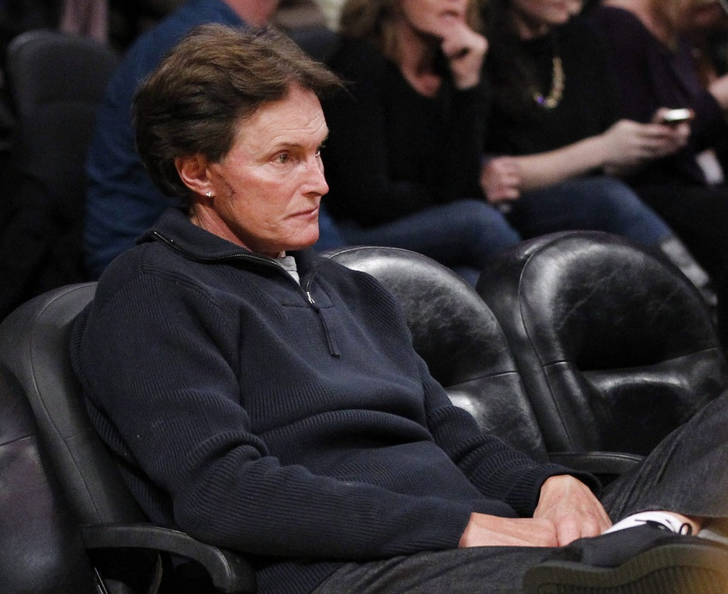 Former Olympic athlete Bruce Jenner, with stitches and a scar on his face, attends an NBA basketball game in 2012. (Danny Moloshok/AP)