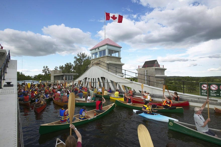People in canoes travelling through Peterborough lift the lock on Trent-Severn Waterway in Peterborough, Ontario. (Trent Photographics-Michael Cullen)