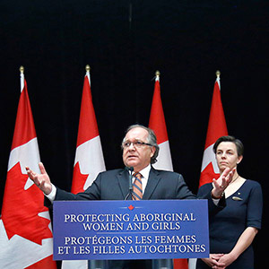 Canada's Aboriginal Affairs Minister Valcourt speaks during a news conference with Labour and Status of Women Minister Leitch in Ottawa