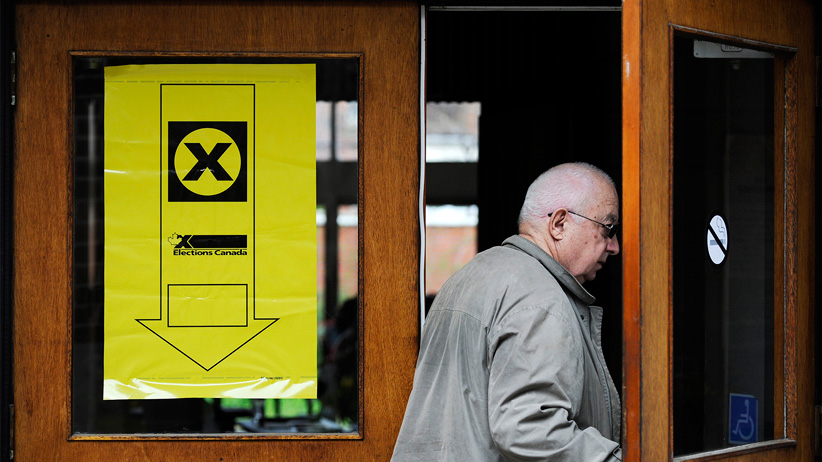 A voter enters a polling station for the Federal Election in Toronto (Mark Blinch/Reuters)