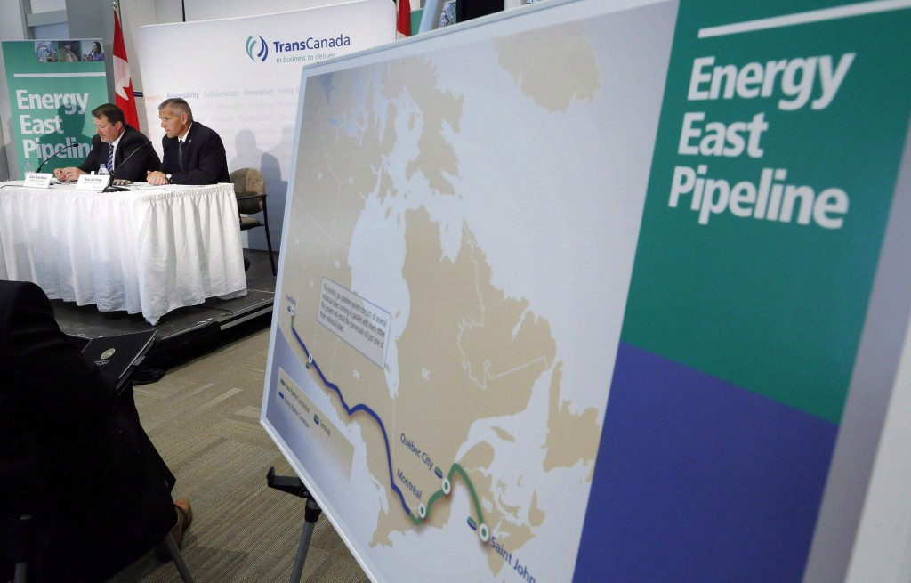 The Energy East pipeline proposed route is pictured as TransCanada officials speak during a news conference in Calgary, on Aug. 1, 2013.  (Jeff McIntosh/CP)