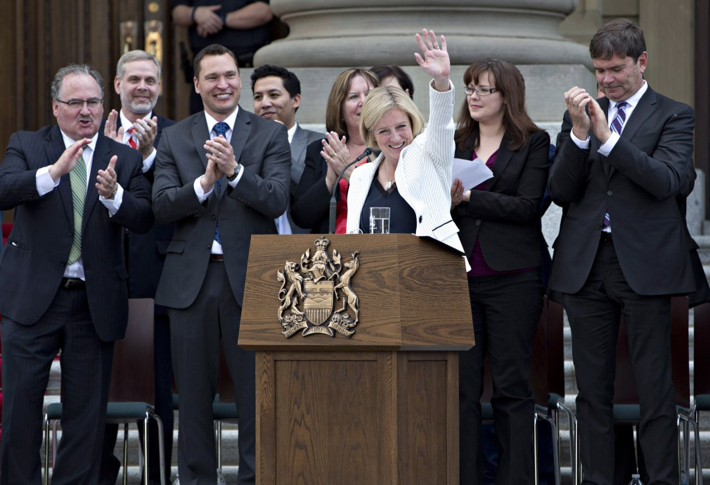 Rachel Notley is applauded after being sworn in as Alberta's 17th premier in Edmonton, Alta., on Sunday, May 24, 2015.(Jason Franson/CP)