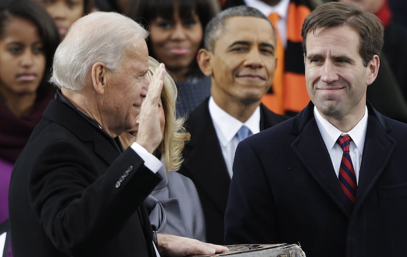 Barack Obama, center and Beau Biden, at the time attorney of Deleware, watch as Joe Biden is sworn in at the ceremonial swearing-in at the U.S. Capitol during the 57th Presidential Inauguration on Jan. 21, 2013. (Pablo Martinez Monsivais, AP)
