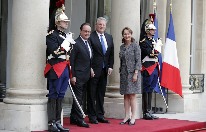 Former U.S. vice President and Environmentalist advocate Al Gore, left, poses as he is welcomed by French President Francois Hollande, center, and French Minister for Ecology, Sustainable Development and Energy Segolene Royal, right upon his arrival for a meeting at the Elysee Palace in Paris, France, May 18, 2015. (AP Photo/Francois Mori)