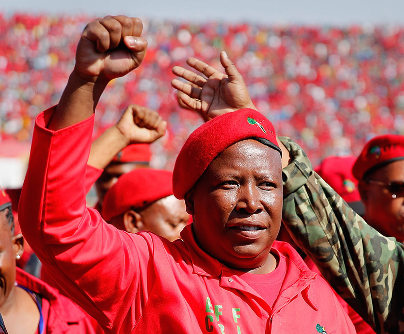 Julius Malema greets supporters as he enters the Lucas Moripe Stadium for an Economic Freedom Fighters presidential campaign rally in 2014.  (J. Countess/Getty Images)